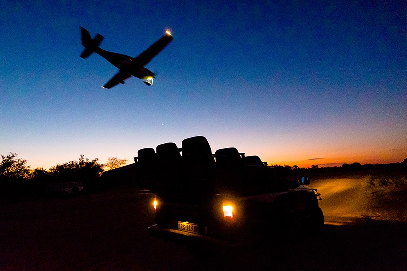 Aircraft coming in to land at dusk in the Timbavati Game Reserve